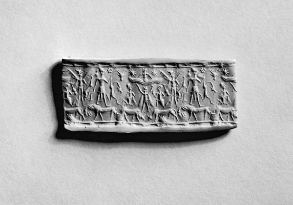 800px-Mitannian_-_Cylinder_Seal_with_a_Row_of_Human_Figures_above_Animals_-_Walters_42685