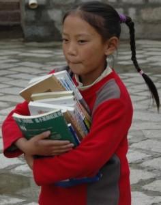 girl-carrying-books-236x300