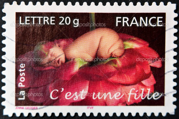 FRANCE - CIRCA 2005: A stamp printed in France shows sleeping baby in a rose, circa 2005