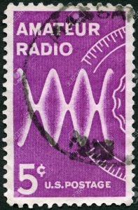UNITED STATES OF AMERICA - CIRCA 1964: A stamp printed in USA shows Radio Waves and Dial, dedicated to the 100th anniversary of the Amateur Radio, circa 1964