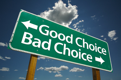 Good Choice, Bad Choice Road Sign with blue sky and clouds.