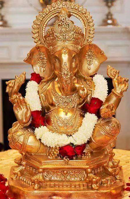 This image has an empty alt attribute; its file name is ganesh-gold.jpg